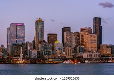 Seattle Skyline by night. Downtown Seattle cityscape seen from the Elliot Bay during twilight, Washington state, USA.