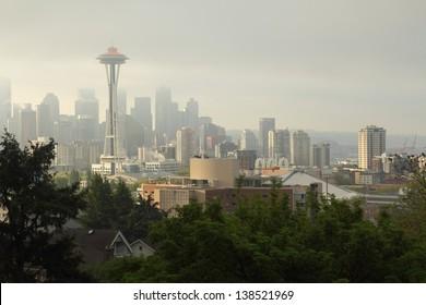 Seattle Skyline, Morning Mist. Fog lingers around downtown Seattle at sunrise. Washington State, USA.