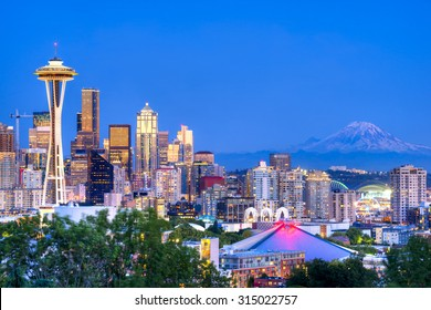 Seattle skyline and Mount Rainier in the background.