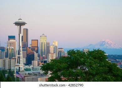 Seattle skyline with mt Rainier at dusk