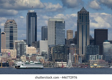 Seattle Skyline. A summertime view of the Seattle skyline looking from west Seattle across Elliott Bay. Cruise ships, ferryboats, tugboats, and freighters are a common sight in this maritime city.