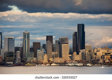 Seattle Skyline. Sunlight breaks through the clouds to illuminate a small section of Seattle's lovely waterfront area making for a dramatic skyline image.