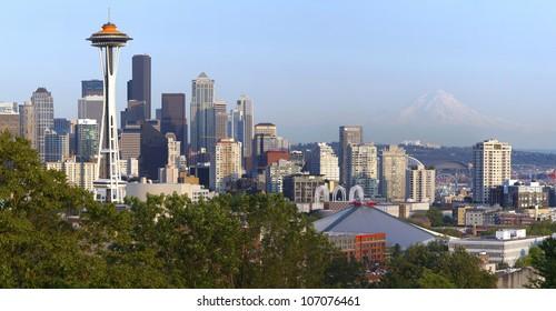 Seattle skyline at sunset and Mt. Rainier.