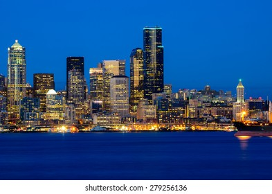 Seattle skylines in blue hour from Alki Beach, West Seattle, Washington, USA.