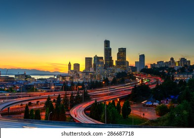 Seattle skylines and highway traffic motion in the sunset. The view from Rizal Park in Seattle, Washington, US. City scape and high speed concept.