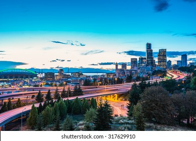 Seattle skylines and Interstate freeways converge with Elliott Bay and the waterfront background of in sunset time, Seattle, Washington State, USA.