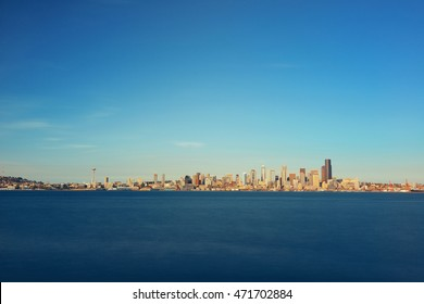 Seattle sunrise skyline view with urban office buildings.