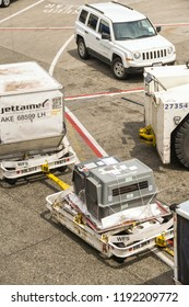 SEATTLE TACOMA AIRPORT, WA, USA - JUNE 2018: Container holding a live animal being transported on trainers for luggage containers at Seattle Tacoma airport.