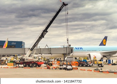 SEATTLE TACOMA AIRPORT, WA, USA - JUNE 2018: Large mobile crane lifting a heavy piece of airport equipment for improvements at Seattle Tacoma airport