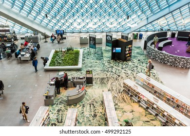 Seattle, USA - April 15, 2016: Aerial view of main floor of the public Central Library with modern glass architecture