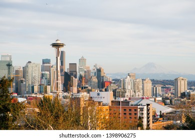 Seattle, USA. April 2019. View of Seattle's sunset downtown and the Space Needle and Mount Rainier