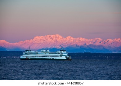 Seattle, USA February 25, 2011: Washington State Ferry crossing Puget Sound in winter Dawn alpenglow