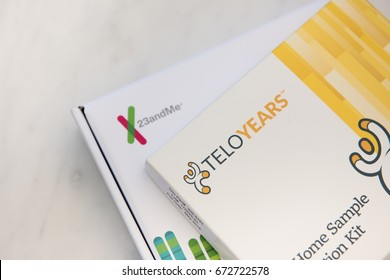 SEATTLE, USA - July 6, 2017: New Telomere Age Test Kit for Cellular Age from Telomere Diagnostics Inc., and Saliva Collection Kit from 23andMe DNA for Ancestry and Health Test.