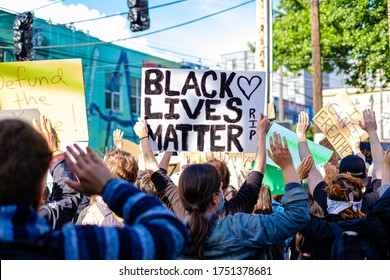 SEATTLE, USA - JUNE 6, 2020: Protesters in a demonstration against racism near a Seattle Police precinct