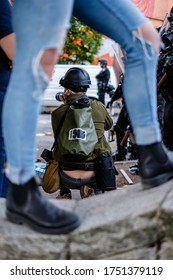 SEATTLE, USA - JUNE 6, 2020: Photographer documenting the demonstration after Seattle Police dispersed the crowd with flash bangs and pepper spray