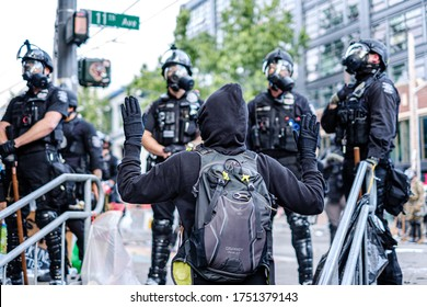 SEATTLE, USA - JUNE 6, 2020: Demonstrator with hands up after Seattle Police dispersed the crowd with flash bangs and pepper spray
