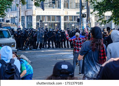 SEATTLE, USA - JUNE 6, 2020: Seattle Police holds the perimeter after dispersing demonstrators with flash bangs and pepper spray