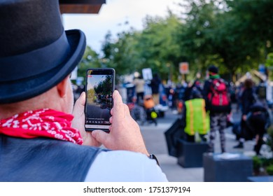 SEATTLE, USA - JUNE 6, 2020: A protester bradcast live after Seattle Police dispersed demonstrators with flash bangs and pepper spray