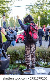 SEATTLE, USA - JUNE 6, 2020: Demonstrators with hands up after Seattle Police dispersed the crowd with flash bangs and pepper spray
