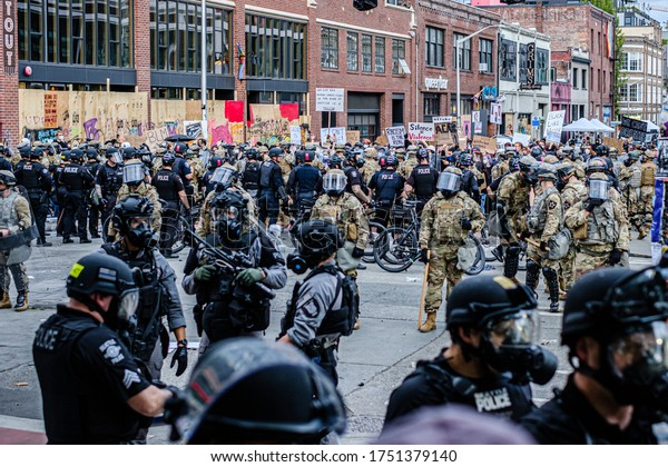 SEATTLE, USA - JUNE 6, 2020: Seattle Police and National Guard hold the perimeter after dispersing demonstrators with flash bangs and pepper spray