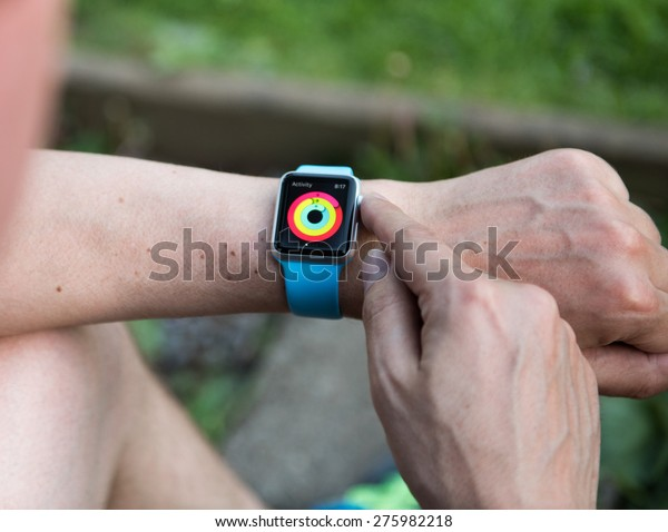 SEATTLE, USA - May 7, 2015: Man Checking Out Activity App on Apple Watch While Working Out Outside.