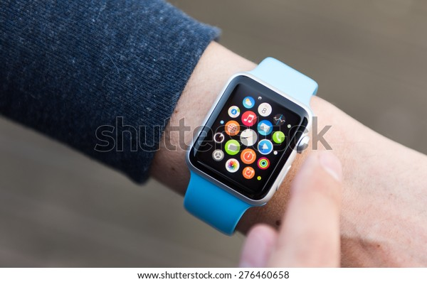 SEATTLE, USA - May 9, 2015: Man Using App on Apple Watch While Outside. Multiple Apps View.