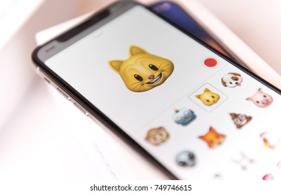 SEATTLE, USA - November 3, 2017:  New iPhone X in Silver in Messaging App with Animoji Selection.