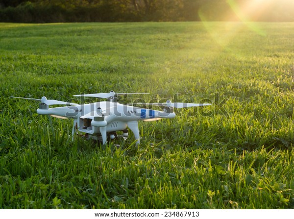 Seattle, USA - October 9, 2014: Camera drone on a grassy field at sunset