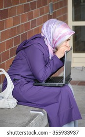 SEATTLE, WA __CIRCA JUNE 2, 2008__Muslim woman on a visa to the united states to get married using her computer at a public library to help find a job for her language skills.