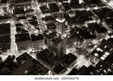 SEATTLE, WA - AUG 14: Smith Tower rooftop night view with street on August 14, 2015 in Seattle. Completed in 1914, it is the oldest skyscraper in Seattle.