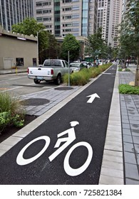 SEATTLE, WA - AUGUST 31, 2016: The 7th Avenue Cycle Track, a public bike lane funded by Amazon, runs alongside their new 3.3 million SF headquarters complex in Seattle's Denny Regrade neighborhood.