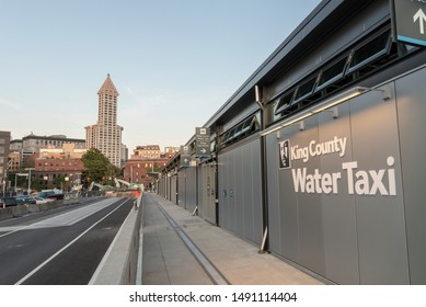 Seattle Wa circa August 2019 the new King County water taxi terminal with the Smith tower at dusk.