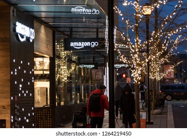 Seattle, Wa circa December 2018 the Amazon Go campus store at night with customers and lit tree.