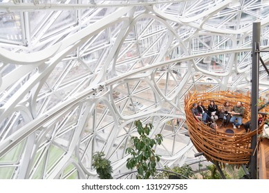 Seattle, Wa circa February 2019 Interior views of the Amazon world headquarters Spheres green house terrariums, birds nest with people chatting.