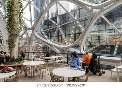 Seattle, Wa circa February 2019 Interior views of the Amazon world headquarters Spheres green house terrariums, employee cleaning table.