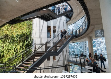 Seattle, Wa circa February 2019 Interior views of the Amazon world headquarters Spheres green house terrariums, levels with stairs and people.