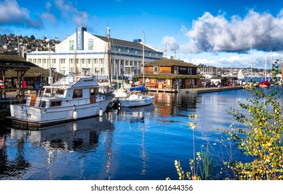 SEATTLE, WA- Dec. 4, 2016: Center for Wooden Boats on Lake Union. Museum of History and Industry in the background. Bright beautiful sunny day with dramatic clouds and reflections