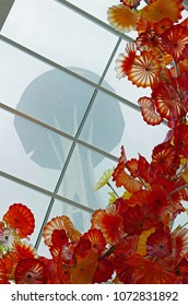 Seattle, WA, December 29, 2017: The Space Needle seen through the conservatory with glass art by Chihuly