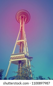 SEATTLE, WA - JULY 28, 2017: Built for 1962 World's Fair, Seattle's Space Needle is one of the most recognizable landmarks in the world seen here from the city center below (vintage/cross proce