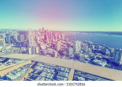 SEATTLE, WA - JULY 28, 2017: View of downtown Seattle from the iconic Space Needle with mount Hood in the distance (vintage/cross processed editing) on July 28, 2017