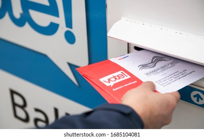 Seattle, WA - March 10, 2020: Washington State's Mail in Ballots for Presidential Primary Elections Being Dropped off at Designated Collection Box