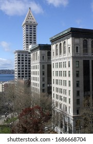 Seattle, WA - March 21, 2020: View of Smith Tower in the background and the King County Courthouse in the foreground.    City Hall Park is also displayed in the left foreground.