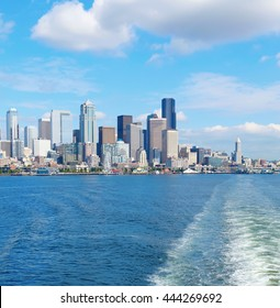 Seattle, WA - March 23, 2011:  Seattle waterfront Pier 55 and 54. Downtown view from ferry.