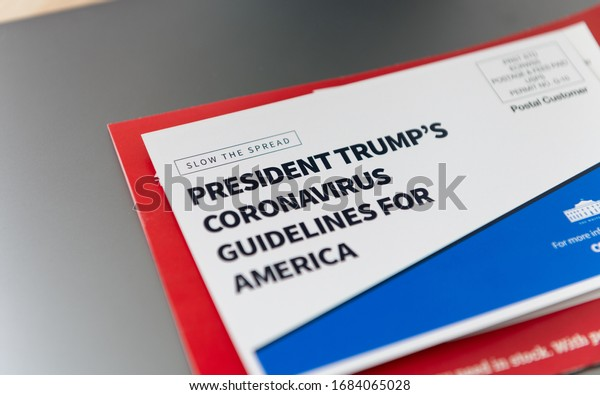 Seattle, WA - March 26, 2020: Post Card Sent Out to Residents of United States from White House and CDC with Guidelines about Coronavirus Pandemic. Link to Official Website.