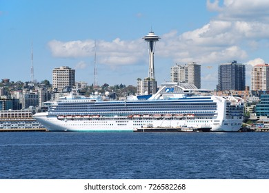 SEATTLE, WA - MAY 12, 2011: Princess Cruises' Sapphire Princess is docked at Seattle's Bell StreetCruise Terminal at Pier 66, preparing for an Alaskan Cruise with the Space Needle in the background