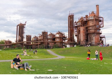 SEATTLE, WA, MAY 6, 2018: People gather at Gas Works Park to enjoy a late spring afternoon. The 19 acre public park sits on the site of the former Seattle Gas Light Company gasification plant.