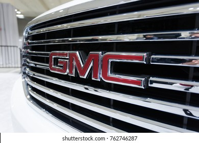 SEATTLE, WA - NOVEMBER 12, 2017: Seattle International Auto Show. Close-up view of the front of the white GMC car with the company logo.