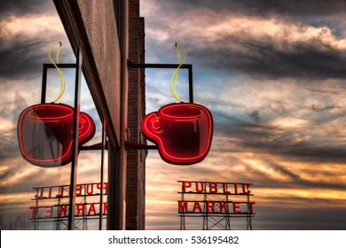 SEATTLE, WA - SEPTEMBER 21, 2011: Neon coffee cup and Pikes Place Market sign at sunset. Seattle is associated with coffee, as the birthplace of Starbucks.
