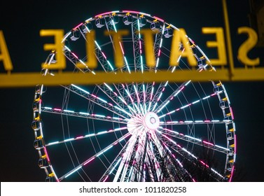Seattle WA USA : 01/22/2018  View of  Great Wheel at night from Seattle Aquarium.