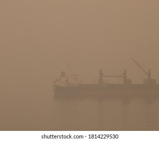 Seattle, WA, USA - 09.12.2020 Unhealthy smoke over the water with a ship in Seattle from wildfires in California, Washington and Oregon.